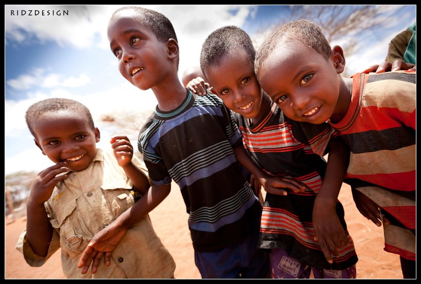 Smiles in WajirEven with all the hardship and struggle... they still have something to smile about... they have something to hope for...So the next time you find yourself struggling to smile think about these young men and remember that there is always a reason to smile...© 2011 Ridwan Adhami