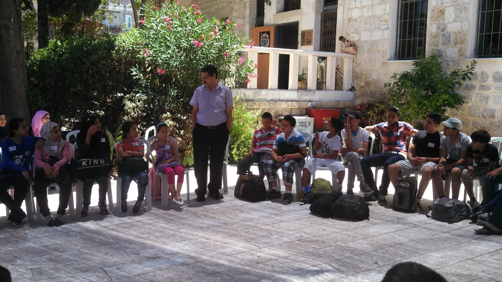 Kids asking Jafar Farah of Moassawa questions about Haifa